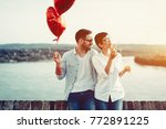 couple in love holding red... | Shutterstock . vector #772891225