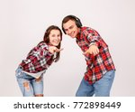the guy with the girl shows a... | Shutterstock . vector #772898449