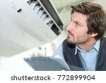 technician holding clipboard... | Shutterstock . vector #772899904
