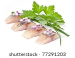 Stock photo herring isolated pieces of salt fillet with onion 77291203