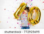 happy little girl holding two... | Shutterstock . vector #772925695