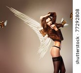 beautiful erotic woman with wings and flying masks - stock photo