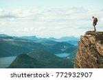 man explorer standing on cliff... | Shutterstock . vector #772932907