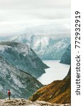 man backpacker hiking in norway ...   Shutterstock . vector #772932919