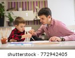 father and son are painting... | Shutterstock . vector #772942405