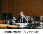 senior businessman working on... | Shutterstock . vector #772944739