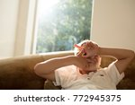little boy peeking through his... | Shutterstock . vector #772945375