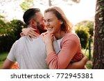happy young couple having fun... | Shutterstock . vector #772945381