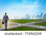 young businessman at crossroads ...   Shutterstock . vector #772962109