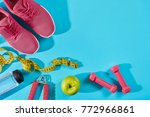 sneakers with measuring tape on ... | Shutterstock . vector #772966861