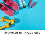 Small photo of Female sport shoes and equipment top view, copy space. Active lifestyle, body care concept.