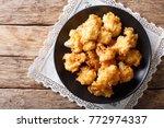 fried fresh cauliflower in... | Shutterstock . vector #772974337