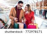 beautiful young couple enjoying ... | Shutterstock . vector #772978171