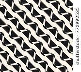 diagonal wavy stripes texture....   Shutterstock .eps vector #772992535