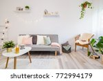 home interior with gray couch ...   Shutterstock . vector #772994179