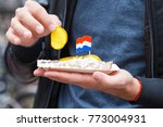 Stock photo traditional dutch food herring fish with onion in fastfood market of amsterdam netherlands 773004931