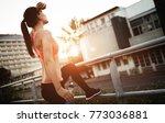 tired female jogger resting | Shutterstock . vector #773036881