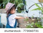 asian little girl is washing... | Shutterstock . vector #773060731