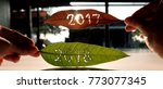 Small photo of New Year 2018 is coming concept - like dry leaf 2017 is fall and green leaf 2018 still living