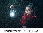 girl holding the lamp while... | Shutterstock . vector #773111065