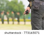 security guard hand holding cb... | Shutterstock . vector #773165071