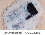 Small photo of Your phone wet - putting it in a bag of silica gel filler to absorb the moisture. Wet smartphone repair in silica gel filler from your cat's