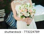 bride holding wedding flower... | Shutterstock . vector #773224789