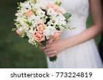 bride holding wedding flower... | Shutterstock . vector #773224819