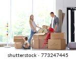 happy family unpacking... | Shutterstock . vector #773247445