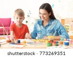 cute boy with mother painting... | Shutterstock . vector #773269351