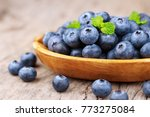 blueberries in a bowl on a... | Shutterstock . vector #773275084