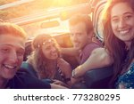 group of happy people in a car... | Shutterstock . vector #773280295