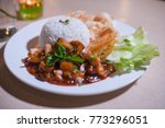 Small photo of Chicken paprika with sweet sauce served with rice on a white plate.Close up shot.