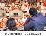 back view of tourists playing... | Shutterstock . vector #773301205