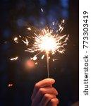 sparkler in hand. man holds...   Shutterstock . vector #773303419