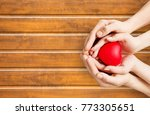 human hands with red heart | Shutterstock . vector #773305651