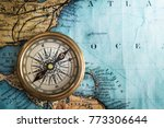 compass on vintage map.... | Shutterstock . vector #773306644