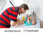 loving father changing diaper... | Shutterstock . vector #773309485