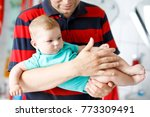 happy proud young father having ... | Shutterstock . vector #773309491