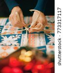 christmas present   wrap a gift | Shutterstock . vector #773317117