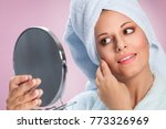 young woman with mirror in hand ... | Shutterstock . vector #773326969