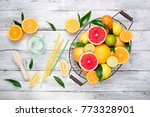 citrus fruits background.... | Shutterstock . vector #773328901