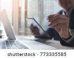 smart businessman in black suit ... | Shutterstock . vector #773335585