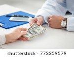 woman giving money to doctor in ... | Shutterstock . vector #773359579