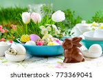 easter table setting with...   Shutterstock . vector #773369041