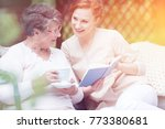 caregiver reading a book and... | Shutterstock . vector #773380681