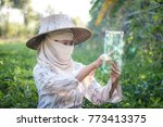 farmer using clear tablet with...