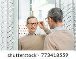 smiling caucasian man choosing... | Shutterstock . vector #773418559