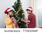 young couple family decorating... | Shutterstock . vector #773424469