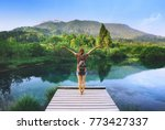 young woman stands on a wooden... | Shutterstock . vector #773427337